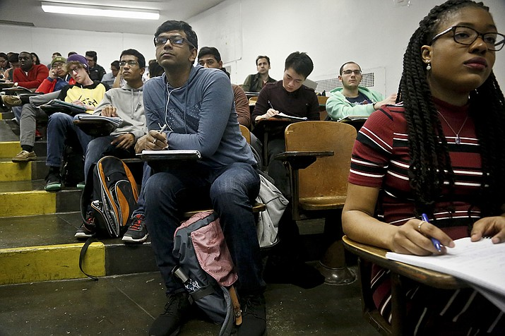 Rhode Island has became the fourth state to offer two years of community college free for state residents, joining New York, Oregon and Tennessee. Arizona struggles to even pay for K-12 education. (AP fuel photo of New York college students/Bebeto Matthews)