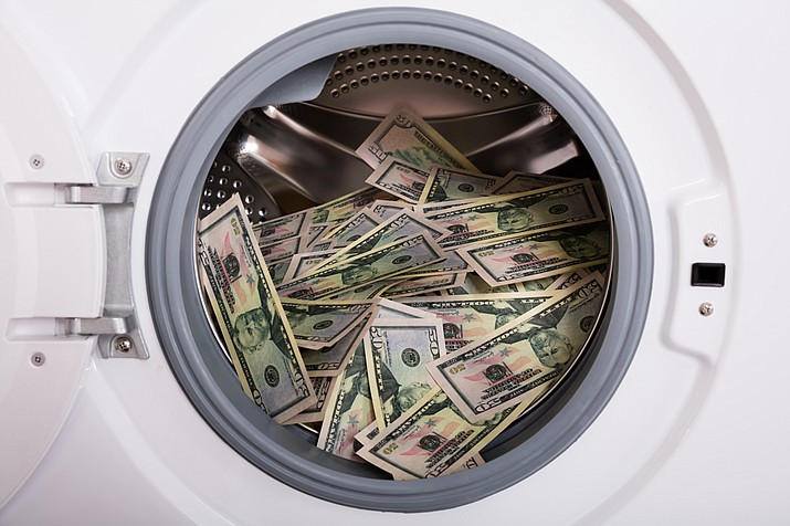 A hospital laundry room worker in Providence, R.I. noticed $50 and $100 bills billowing out of an open dryer last month. He gathered up $9,100 in all and turned it over to administrators, who made sure it was returned to an unnamed patient. (Stock art image)