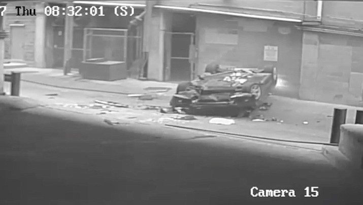 Police in Austin, Texas released video of a car falling seven stories from a parking garage, hitting another car below. The female driver survived the fall. (Image from video via AP)