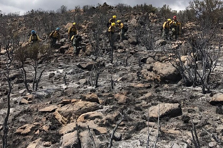The Perryville crew helping out on the Sweetwater Fire southeast of Kingman in rugged terrain.