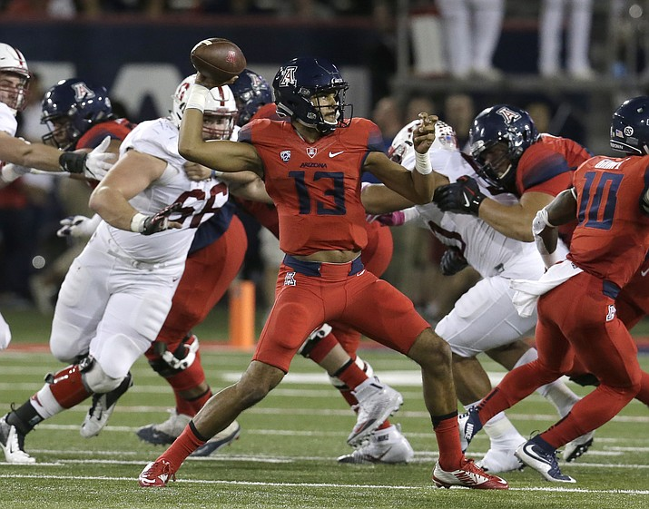 In this Oct. 29, 2016, file photo, Arizona quarterback Brandon Dawkins (13) throws during the first half against Stanford in Tucson. (Rick Scuteri/AP, File)