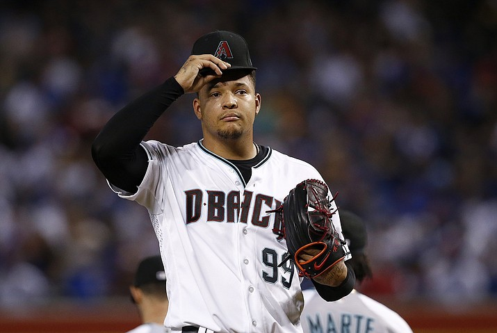 Arizona Diamondbacks' Taijuan Walker pauses on the mound after giving up two runs to the Chicago Cubs during the first inning of a baseball game Friday, Aug 11, 2017, in Phoenix. (Ross D. Franklin/AP)