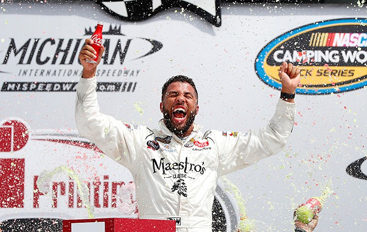 Darrell Wallace Jr. celebrates winning the NASCAR Cup Series truck race in Brooklyn, Mich., Saturday, Aug. 12.
