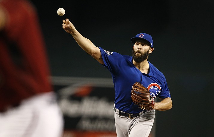 Chicago Cubs' Jake Arrieta, right, throws a pitch against Arizona Diamondbacks' David Peralta during the first inning of a baseball game Sunday, Aug 13, 2017, in Phoenix. (AP Photo/Ross D. Franklin)