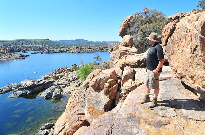 Chris Hosking, City of Prescott trails coordinator, looks over some the views along the new Watson Lake Trail. This is the completion of the 5-mile loop around Watson Lake and should be finished in several months, according to Hosking.