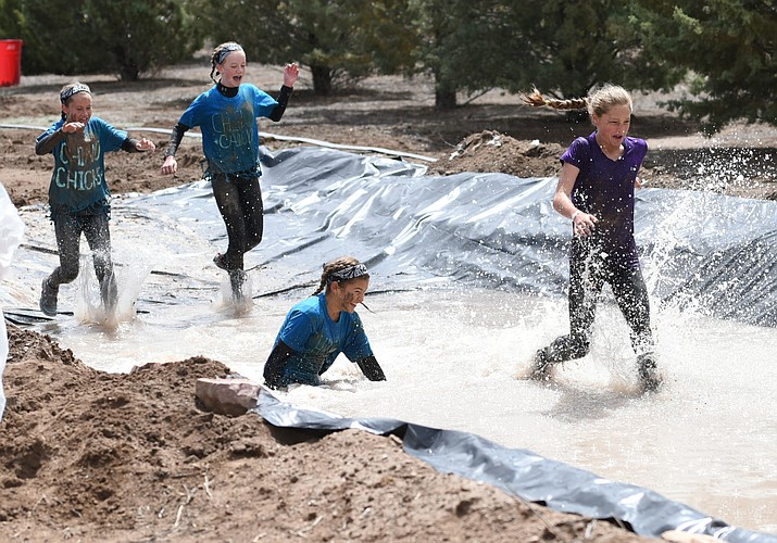 Four runners hit the final obstacle during the 2016 Chino Mudder. (Les Stukenberg/Review, file)