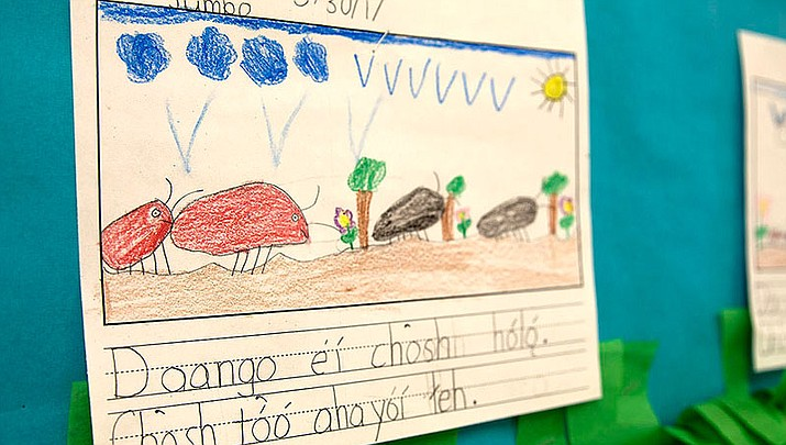 A student's drawing is displayed in the halls at Diné Bi' Olta' in Window Rock, Arizona. Many assignments like this are written entirely in the Navajo language.