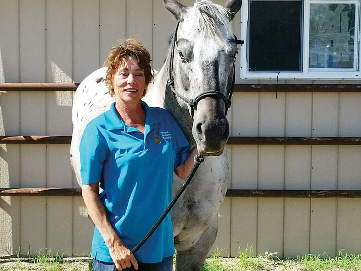 Lucy Berg and one of the rescued horses at the Equine Center. (Review photo)