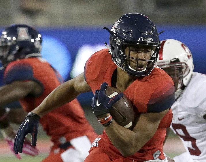 In this Oct. 29, 2016, file photo, Arizona wide receiver Trey Griffey runs away from Stanford safety Ben Edwards (9) during the second half of an NCAA college football game in Tucson. (Rick Scuteri/AP, File)