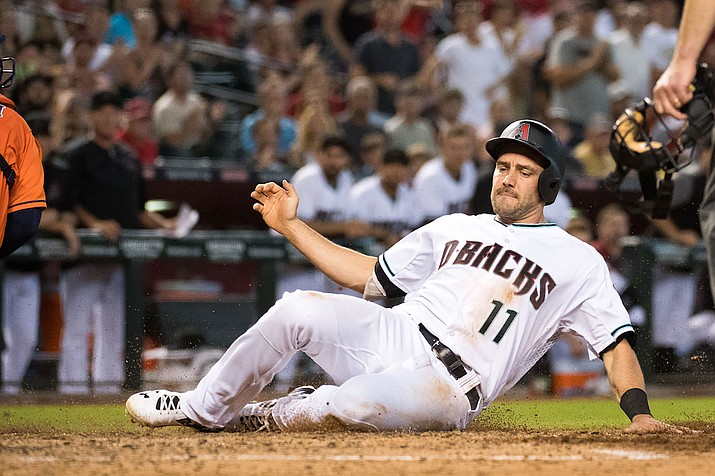 A.J. Pollock slides into home Tuesday during Arizona's loss at home to the Astros.