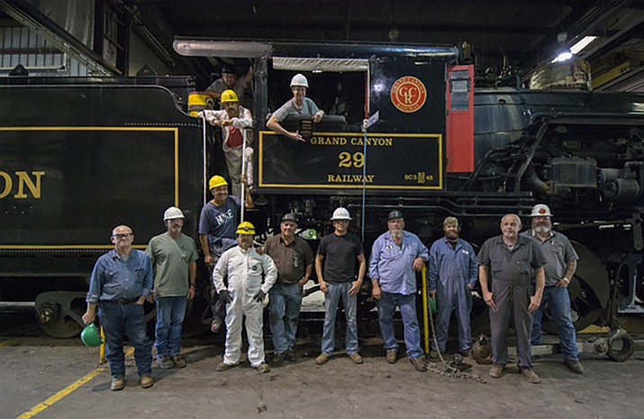 Grand Canyon Railway employees who restored Steam Engine No. 29 pose with their engine. Grand Canyon Railway was honored by the Arizona office of Tourism for the restoration of the engine that was built in 1906.