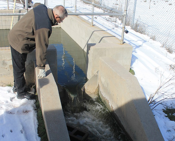 City councilman Bernie Hiemenz observes the treated effluent water at the waste water treatment plant. The city is looking to use the treated water for processes at the plant.