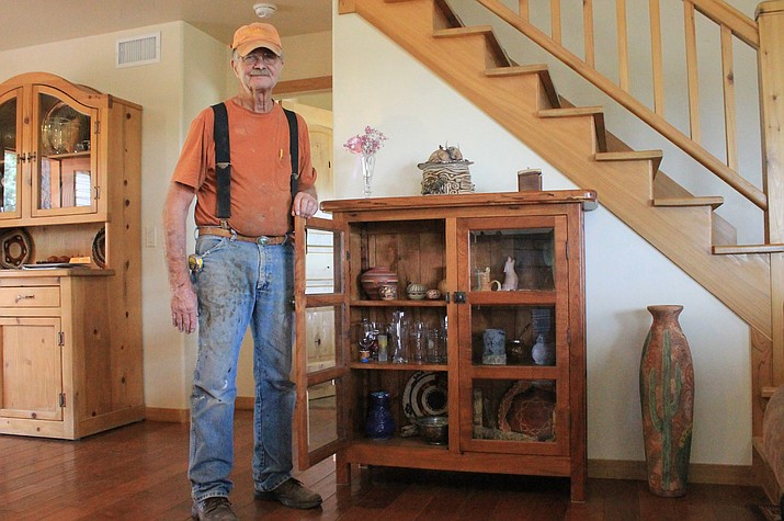 Williams artist Butch Corrington creates cabinets, tables, bed frames and other projects from mesquite and walnut.