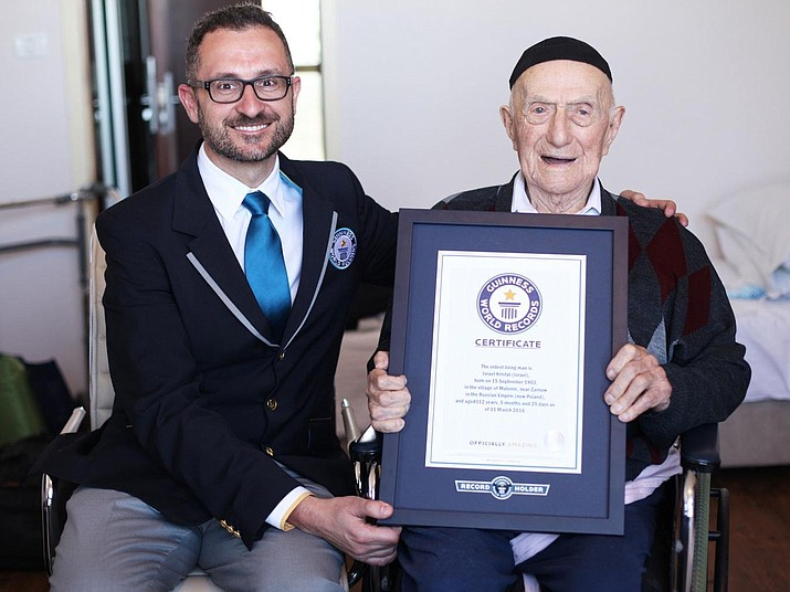 Israel Kristal, 113, receives his certificate from Marco Frigatti, Guinness World Records Head of Records, in March 2016 (Photo courtesy of Guinness World Records)