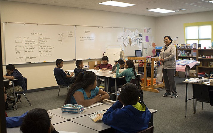 "Gwendolyn Begaye, a fourth-grade teacher at Diné Bi' Olta' school, discusses the book ""Charlotte's Web"" with her class. Instructors at the school are encouraged to speak Navajo to students in every subject every day."