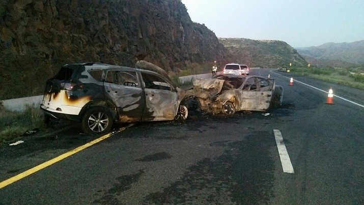 A wrong-way crash injured at least four people in this wreck along southbound Interstate 17, north of Black Canyon City Tuesday, Aug. 15, 2017. (Arizona Department of Public Safety via AP)