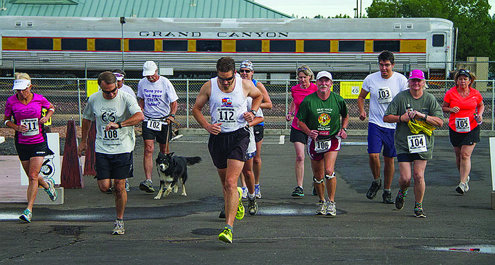 Runners take off during last year's Mountain Man Run in Williams.