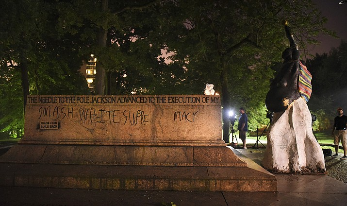 """This photo shows the empty pedestal of the Robert E. Lee and Thomas J. """"Stonewall"""" Jackson monument in Wyman Park early Wednesday, Aug. 16, 2017, after workers took it and several other Confederate monuments down overnight in the city. (Jerry Jackson/The Baltimore Sun via AP)"""