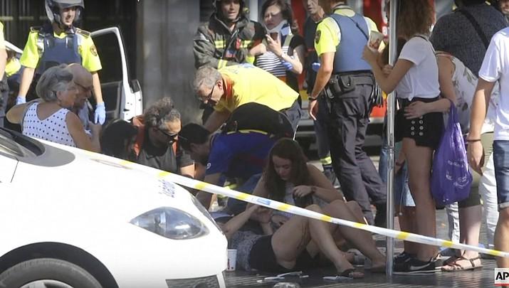 Attacker drives van into Barcelona crowd; 13 dead, 50 hurt