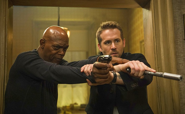 "Samuel L. Jackson, left, and Ryan Reynolds star in ""The Hitman's Bodyguard."" (Jack English/Lionsgate via AP)"