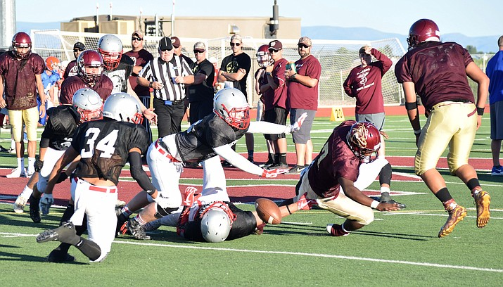 The Marauders defense forces a fumble against Winslow on Wednesday during the  four-way scrimmage at Mingus Union. Marauders head coach Bob Young said the first team defense impressed him. (VVN/James Kelley)