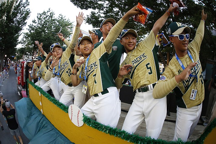 The Asia-Pacific champion team from Seoul, South Korea, rides in the Little League Grand Slam Parade in downtown Williamsport, Pa., on Wednesday, Aug. 16, 2017. The Little League World Series tournament gets underway Thursday. (Gene J. Puskar/AP)