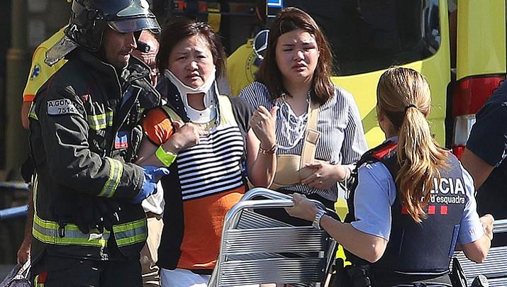 Attacker drives van into Barcelona crowd; 13 dead, 100 hurt