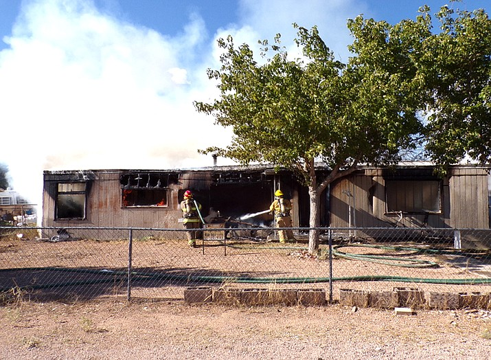 This mobile home in the 3100 block of Butler Avenue was destroyed by fire, which officials are considering suspicious.