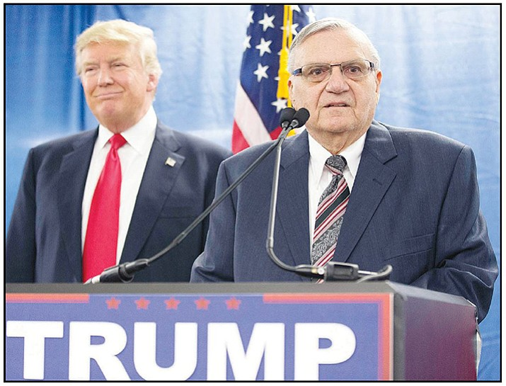 In this 2016 file photo, Republican presidential candidate Donald Trump, left, is joined by Maricopa County Sheriff Joe Arpaio during a new conference in Marshalltown, Iowa. President Donald Trump has pardoned the former sheriff following his conviction for intentionally disobeying a judge's order in an immigration case. (Mary Altaffer/AP, File)