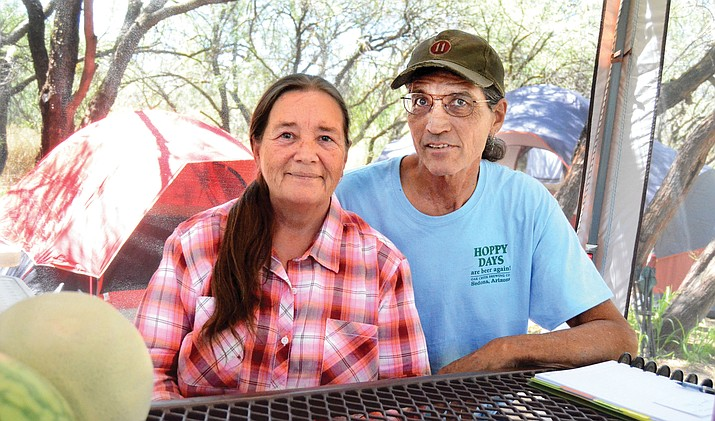 Laurie and Wing, the head of the Sedona Area Homeless Alliance, at their campsite after work Wednesday morning talk about their experience of finding themselves homeless. (VVN/Vyto Starinskas)