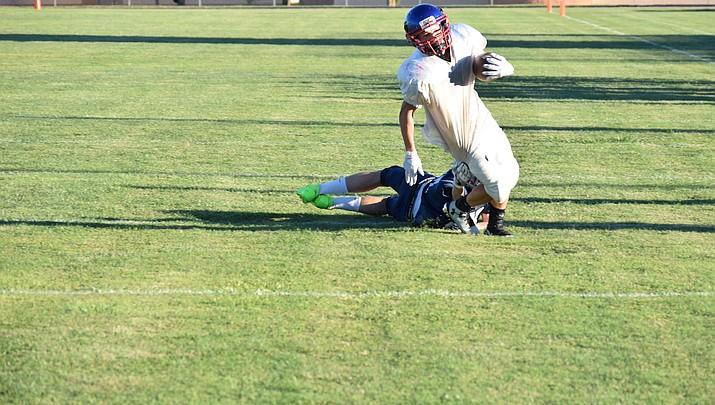 Camp Verde football rolls in scrimmage
