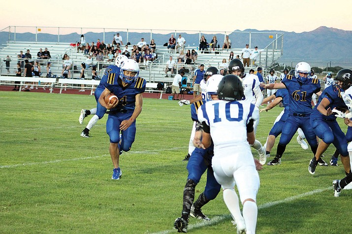 Kingman's Austin Dias ran for 110 yards Friday night in a 26-6 victory over Joy Christian.