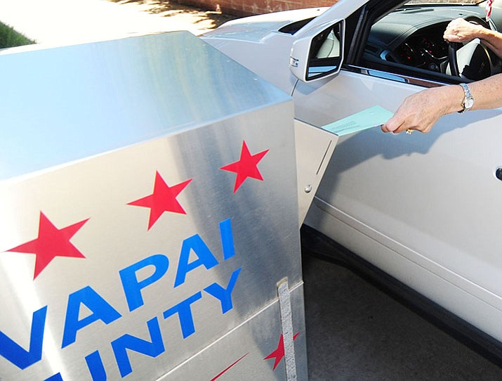 Nancy Stamile drops off her ballot at the Yavapai County building on Fair Street. (Les Stukenberg/Courier)