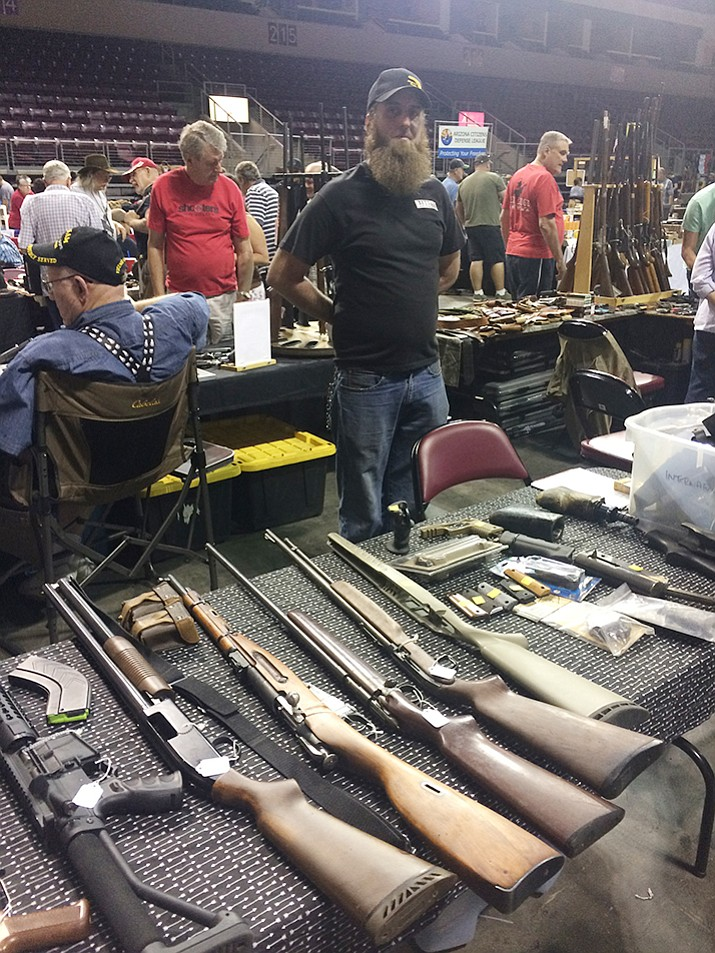 Scott Gustafson with Imperial Arms LLC at the Western Collectibles & Firearms Gun Show at the Prescott Valley Event Center. The show continues today from 9 a.m. to 3 p.m. (Jason Wheeler/Courier)