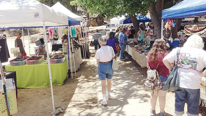 The Arts, Crafts and Antiques Fair at Hualapai Mountain Park June 4 had a steady crowd enjoying the day's mountain climate.