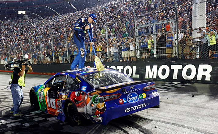 Kyle Busch sweeps the top of his car after winning the NASCAR Cup Series auto race, Saturday, Aug. 19, in Bristol, Tenn. Busch won the NASCAR Trucks, Xfinity and Cup races this week at the track. (Wade Payne/AP)
