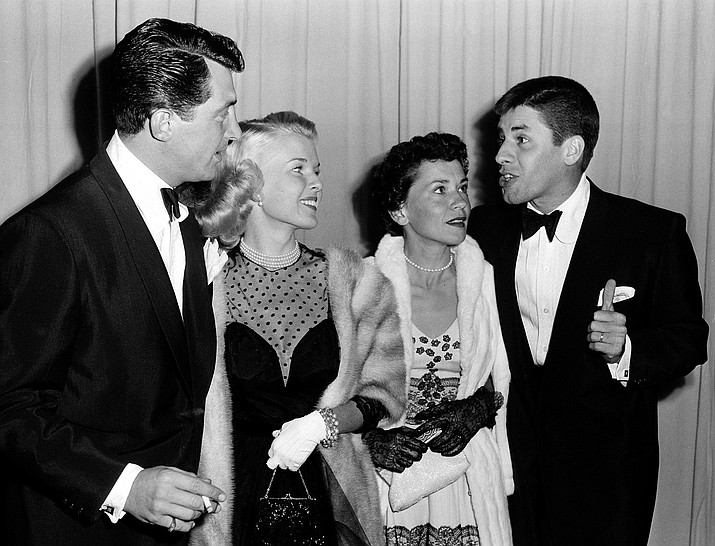 In a March 29, 1951 file photo, actor-comedian Dean Martin, left, and his wife, Jeanne, are shown with actor-comedian Jerry Lewis, far right, and his wife, singer Patti, as they arrive at the Academy Awards presentations at the RKO Pantages Theatre in Los Angeles. Jerry Lewis, the comedian and director whose fundraising telethons became as famous as his hit movies, died Sunday, Aug. 20, 2017, in Las Vegas. He was 91. (AP Photo, File)