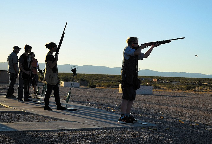 Latigo Barrett, right, fires off a round at Seven Mile Hill Range in Golden Valley.