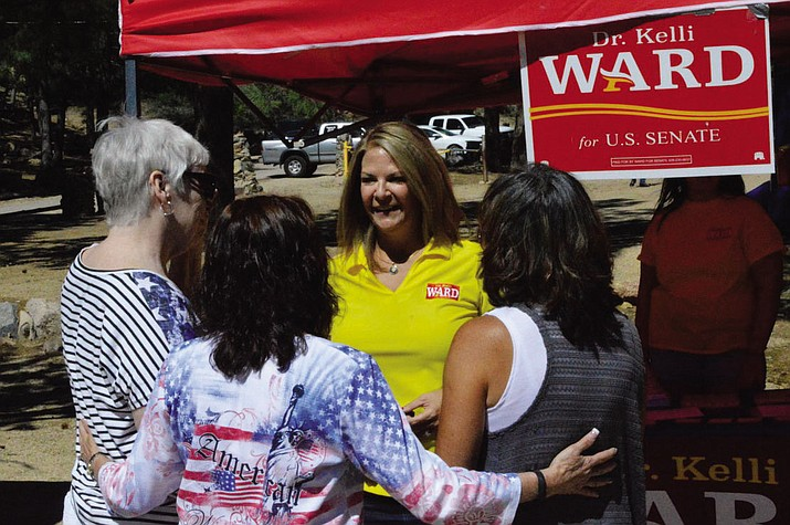 U.S. Senate candidate Kelli Ward (yellow shirt) was in the Hualapai Mountains at the Mohave County Republican 73rd Annual Picnic and fundraiser Saturday.