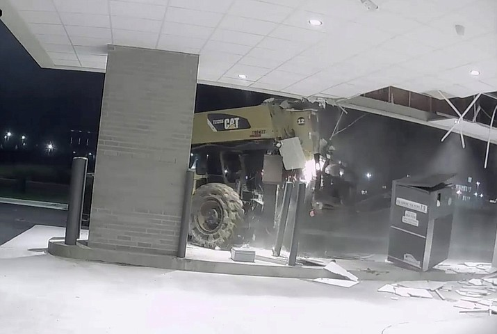 The Conway Police Department posted a video to Facebook showing a person in a forklift tearing the ATM from its foundation and and carrying it away. (Conway Police Department)