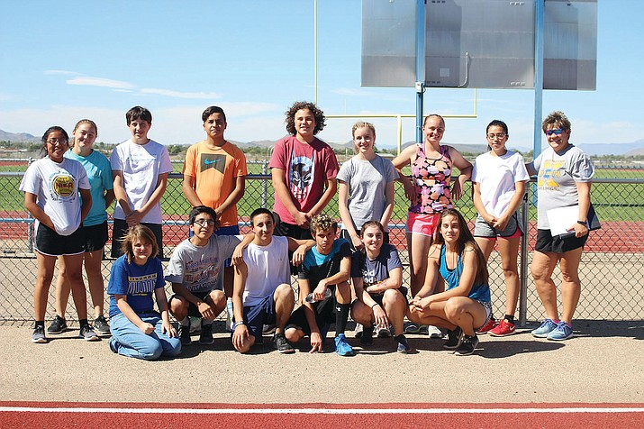 The Kingman High School cross country team: (front row, from left) Alyna Warner, Christine Yazzie, Russario Cirincione, Anthony Hernandez, Taylor Tanner and Lilly May Garcia. Back row, from left: Sienna Silas, Sophia Garcia, David Hammond, Leonel Torro Vazquez, Jason Marquez, Rachel Masters, Julia Ostberg, Norma Canales and coach Anne Bathauer.