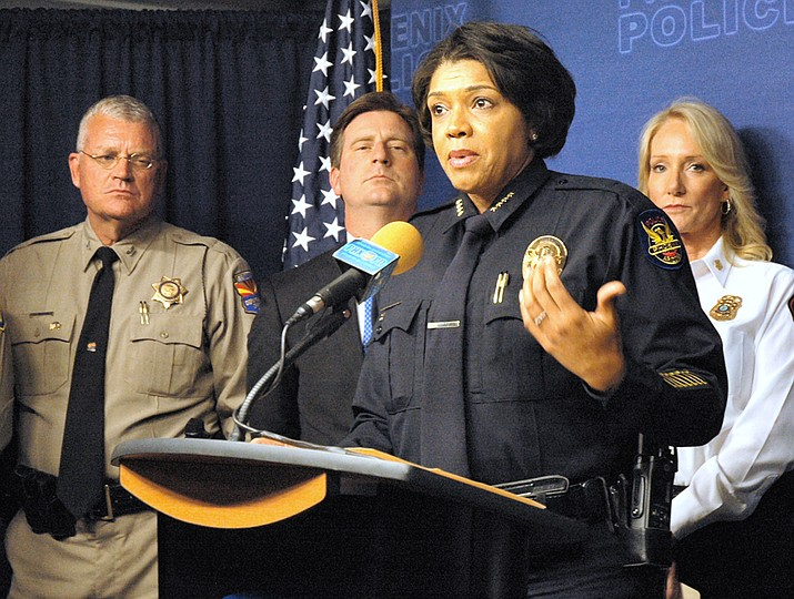 Phoenix Police Chief Jeri Williams explains some of the efforts she said should ensure there is no violence at today's Trump rally even as other groups plan counter protests. With her are DPS Director Frank Milstead, Phoenix Mayor Greg Stanton and Fire Chief Kara Kalkbrenner.(HOWARD FISCHER/Capitol Media Services)