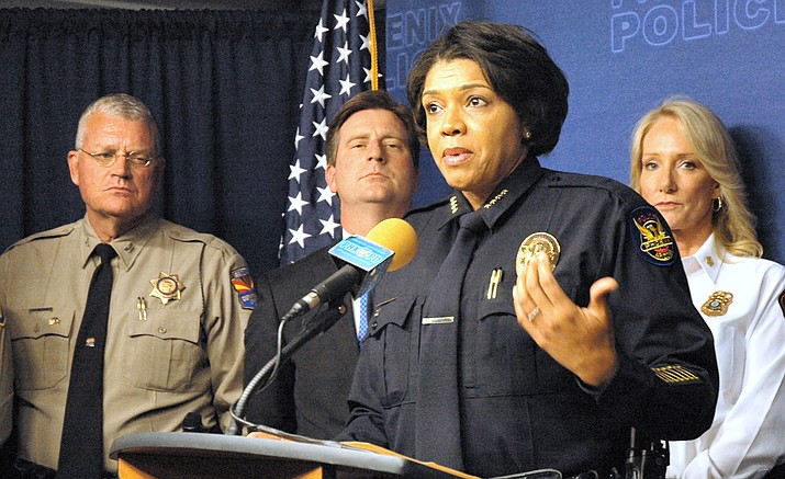 Phoenix Police Chief Jeri Williams explains some of the efforts she said should ensure there is no violence at today's (eds: tuesday) Trump rally even as other groups plan counter protests. With her are DPS Director Frank Milstead, Phoenix Mayor Greg Stanton and Fire Chief Kara Kalkbrenner (Capitol Media Services photo by Howard Fischer