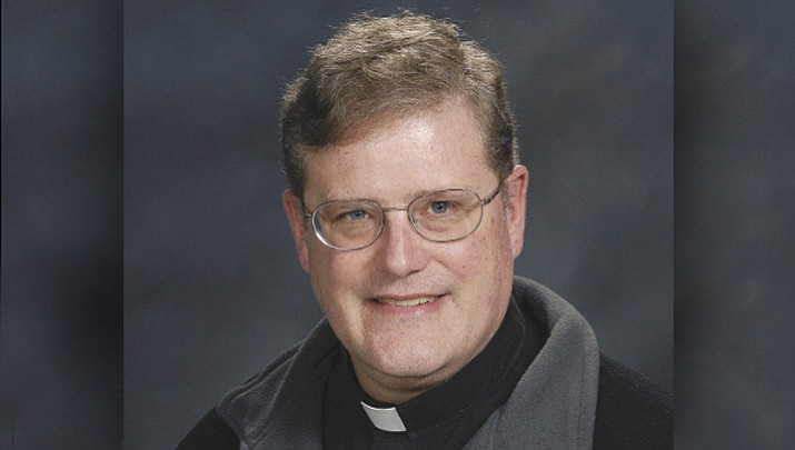 Father William Aitcheson, a priest in the Roman Catholic Diocese of Arlington, is taking a leave of absence after disclosing he once was a member of the Ku Klux Klan. Aitcheson wrote about his past Klan affiliation Monday, Aug. 21, 2017, in The Arlington Catholic Herald, the diocese's newspaper. (Catholic Diocese of Arlington, Va. via AP)