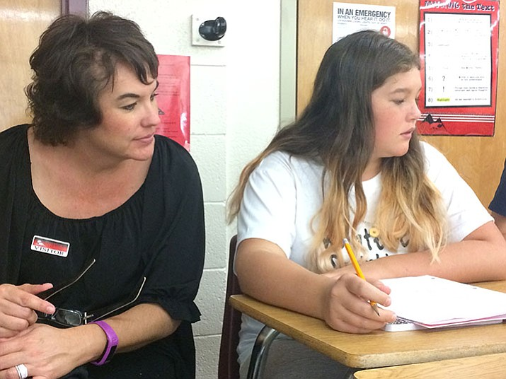 Jennifer Trisdale takes a look at daughter Aliza's work in Diane Hamilton's eighth-grade English Language Arts class during Parent Switch Day at Bradshaw Mountain Middle School on Wednesday, Aug. 23.