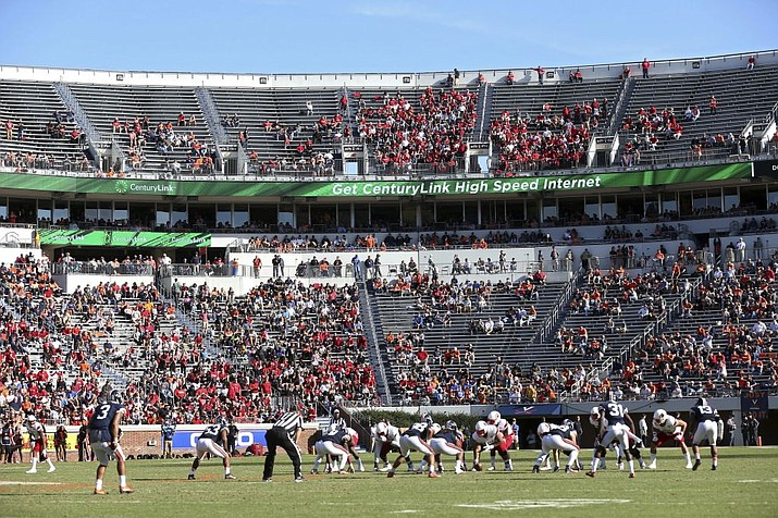 In this Oct. 29, 2016, file photo, Louisville lines up for a play against Virginia during an NCAA college football game in Charlottesville, Va. (Ryan M. Kelly/AP, File)