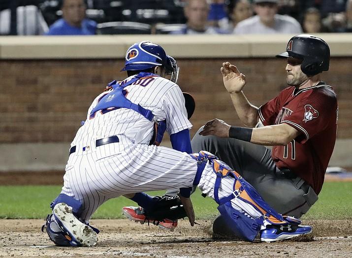 New York Mets catcher Travis d'Arnaud, left, tags out Arizona Diamondbacks' A.J. Pollock, right, on Wednesday, Aug. 23, 2017, in New York. (Frank Franklin II/AP)
