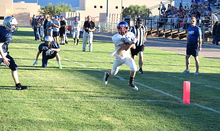 Camp Verde junior Dominiq Bruno runs into the end zone during the Cowboys' scrimmage against Scottsdale Prep last week. Bruno also stars in baseball. (VVN/James Kelley)