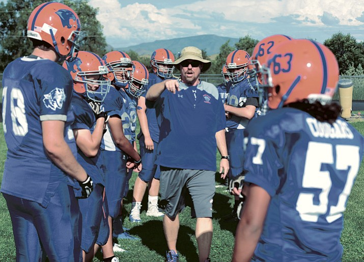 Head coach Wade Krug goes over blocking assignments Aug. 21 in Chino Valley. (Les Stukenberg/Courier)