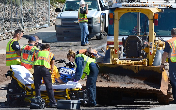 An elderly man riding an ATV was flown to Flagstaff Medical Center Thursday morning after striking a parked backhoe that had been cleaning up debris in Cottonwood. (VVN/Vyto Starinksas)